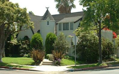 Storybook house with crennelated roofline.