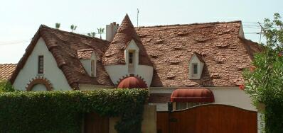 Classic storybook home with exceptionally crafted seawave roof.